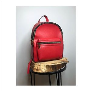 Charming Charlie Faux Red Leather Backpack.